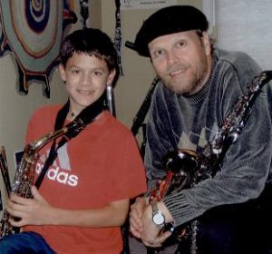 Music instructor Dennis Freese with saxophone student